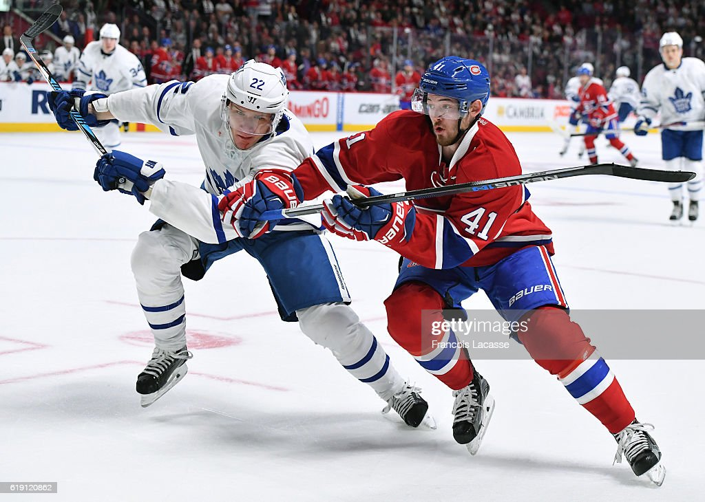 Paul Byron #41 of the Montreal Canadiens and Nikita Zaitsev #22 of the Toronto Maple Leafs battle for position in the NHL game at the Bell Centre on October 29, 2016 in Montreal, Quebec, Canada.