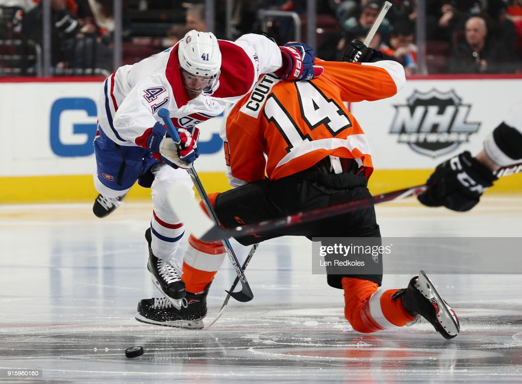 Paul Byron #41 of the Montreal Canadiens battles for the loose puck after a face off with Sean Couturier #14 of the Philadelphia Flyers on February 8, 2018 at the Wells Fargo Center in Philadelphia, Pennsylvania. The Flyers went on to defeat the Canadiens 5-3.