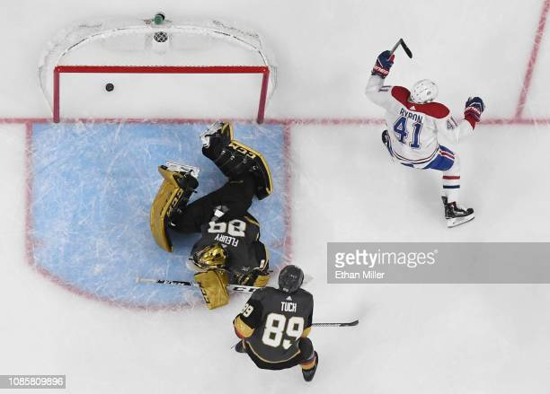 Paul Byron of the Montreal Canadiens celebrates after scoring a goal against MarcAndre Fleury of the Vegas Golden Knights as Alex Tuch of the Golden...