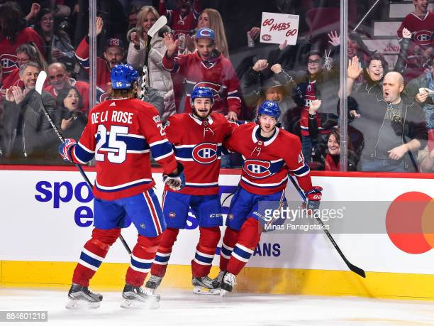 Paul Byron of the Montreal Canadiens celebrates his second period goal with teammates Jacob de la Rose and Victor Mete against the Detroit Red Wings...