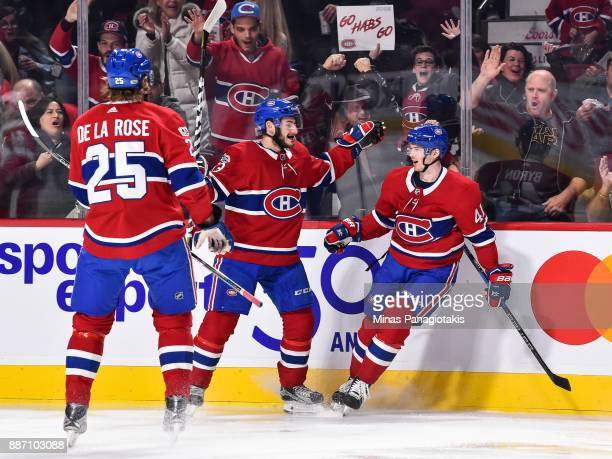 Paul Byron of the Montreal Canadiens celebrates his second period goal with teammates Victor Mete and Jacob de la Rose against the Detroit Red Wings...