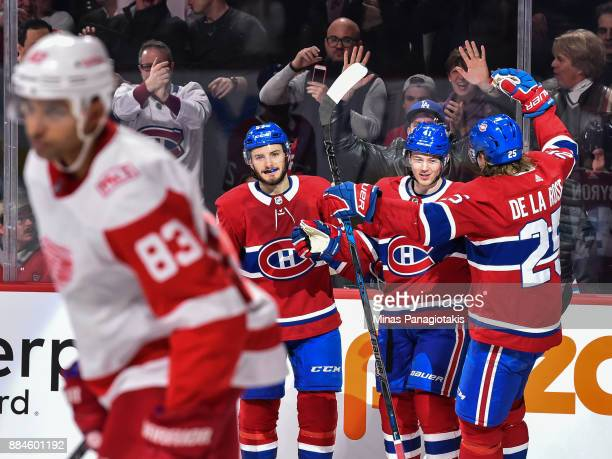 Paul Byron of the Montreal Canadiens celebrates his third goal of the game in the second period with teammates Victor Mete and Jacob de la Rose...