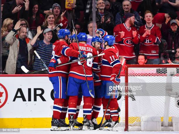 Paul Byron of the Montreal Canadiens celebrates his third period goal with teammates against the Winnipeg Jets during the NHL game at the Bell Centre...
