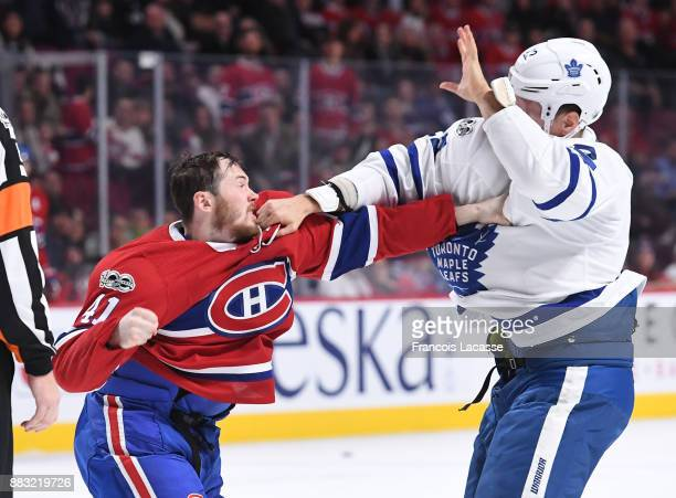 Paul Byron of the Montreal Canadiens fights with Nikita Zaitsev of the Toronto Maple Leafs in the NHL game at the Bell Centre on November 18 2017 in...