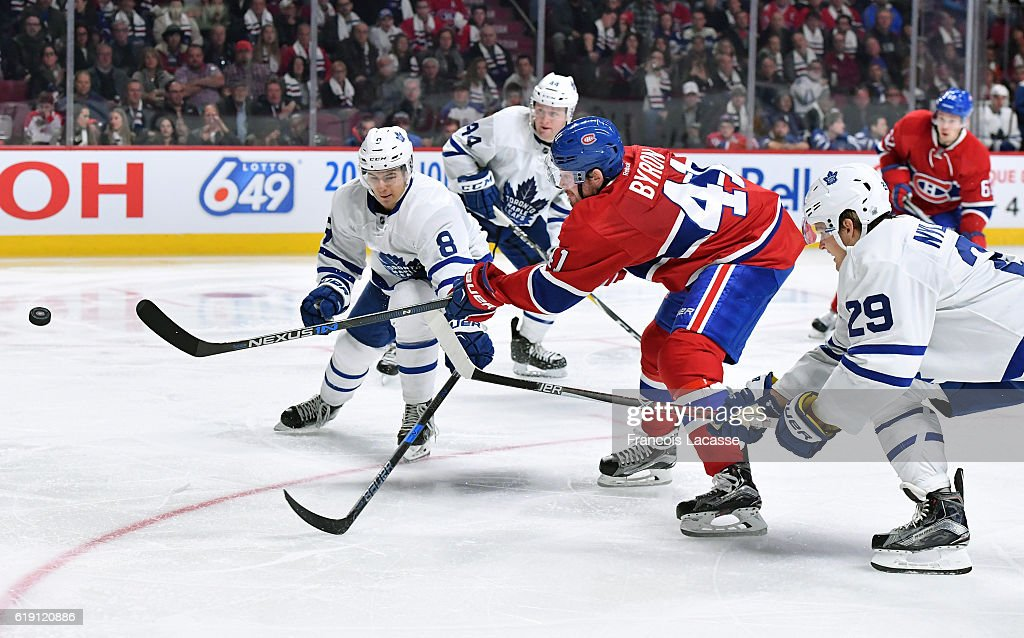 Paul Byron #41 of the Montreal Canadiens takes a shot against Connor Carrick #8 and William Nylander #29 of the Toronto Maple Leafs in the NHL game at the Bell Centre on October 29, 2016 in Montreal, Quebec, Canada.