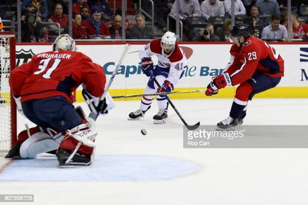 Paul Byron of the Montreal Canadiens takes a shot on goal against Philipp Grubauer and Christian Djoos of the Washington Capitals at Capital One...