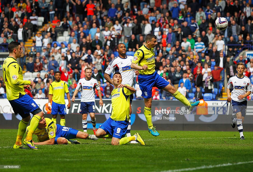 Paul Caddis of Birmingham City scores their second goal with a header to equalise during the Sky Bet Championship match between Bolton Wanderers and Birmingham City at Reebok Stadium on May 3, 2014 in Bolton, England.