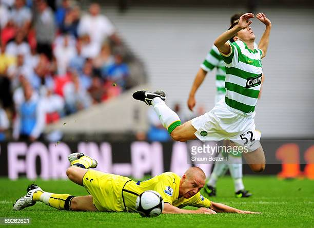 Paul Caddis of Celtic is brought down by Jamie O'Hara of Spurs during the Wembley Cup match between Celtic and Tottenham Hotspur at Wembley Stadium...