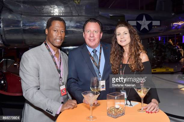Paul Campbell Craig Peterson and Lisa Peterson attend Elite Aerospace Group's 4th Annual Aerospace Defense Symposium at Lyon Air Museum on December...