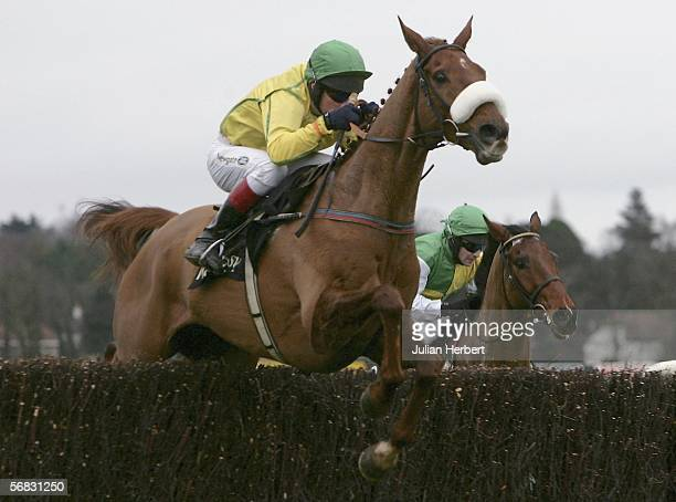 Paul Carberry and Beef Or Salmon lead the David Casey ridden Hedgehunter over the last fence before wining The Hennessy Cognac Gold Cup Steeple Chase...