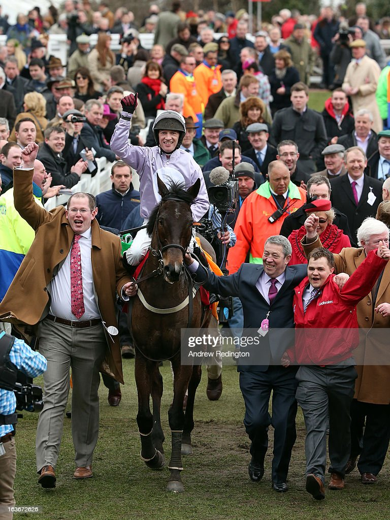 Paul Carberry celebrates on Solwhit after winning the Ladbrokes World Hurdle during the Cheltenham Festival at Cheltenham Racecourse on March 14, 2013 in Cheltenham, England.
