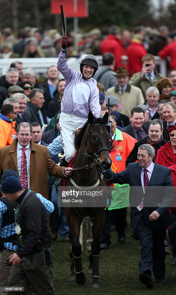 Paul Carberry cheers as he rides his horse Solwhit into the parade ground after winning The Ladbrokes World Hurdle Race at Cheltenham Racecourse on the third day of the Cheltenham Festival 2013 on March 14, 2013 in Cheltenham, England. Approximately 200,000 racing enthusiasts are expected at the four-day festival, which opened on Tuesday and is seen as many as the highlight of the jump racing calendar.