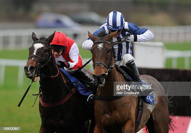 Paul Carberry riding Monbeg Dude clear the last to win The Coral Welsh National from Teaforthree and Tony McCoy at Chepstow racecourse on January 05,...