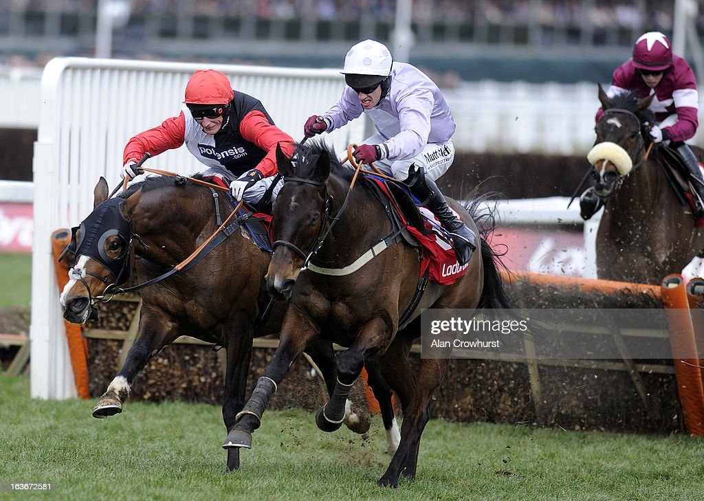 Paul Carberry riding Solwhit (C) clear the last to win The Ladbrokes World Hurdle Race from Celestial Halo (L) during St Patrick's Thursday at Cheltenham racecourse on March 14, 2013 in Cheltenham, England.
