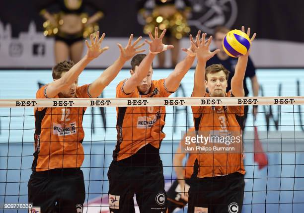 Paul Carroll Graham Vigrass and Robert Kromm of the Berlin Recycling Volleys during the game between the Berlin Recycling Volleys and the VfB...