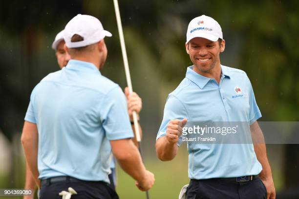 Paul Casey and Tyrrell Hatton of Europe celebrate during the foursomes matches on day two of the 2018 EurAsia Cup presented by DRBHICOM at Glenmarie...
