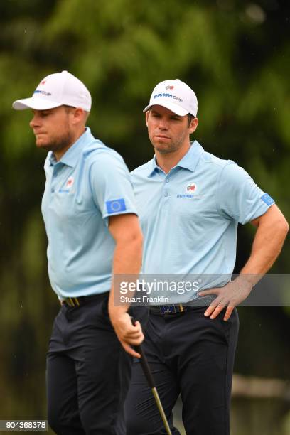 Paul Casey and Tyrrell Hatton of Europe look on during the foursomes matches on day two of the 2018 EurAsia Cup presented by DRBHICOM at Glenmarie...