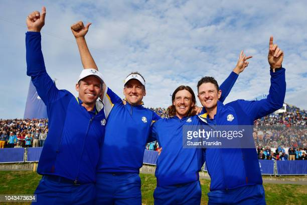 Paul Casey Ian Poulter Tommy Fleetwood and Justin Rose of Europe celebrate winning The Ryder Cup during singles matches of the 2018 Ryder Cup at Le...