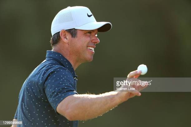 Paul Casey of England acknowledges the crowd on the 16th green during the final round of the Omega Dubai Desert Classic at Emirates Golf Club on...