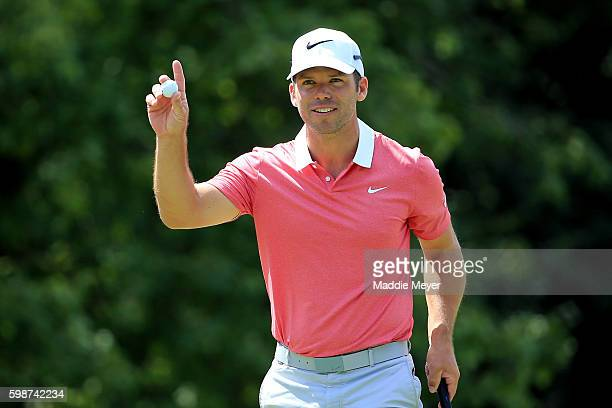 Paul Casey of England acknowledges the crowd on the 18th green during the first round of the Deutsche Bank Championship at TPC Boston on September 2...