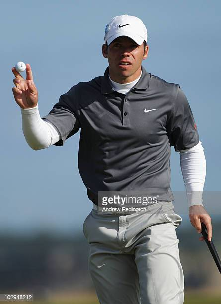 Paul Casey of England acknowledges the crowd on the sixth green during the third round of the 139th Open Championship on the Old Course St Andrews on...