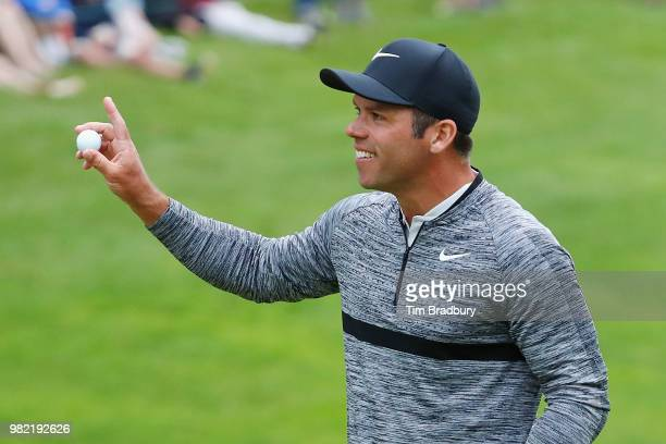 Paul Casey of England acknowledges the gallery after making a putt for birdie on the 18th green during the third round of the Travelers Championship...