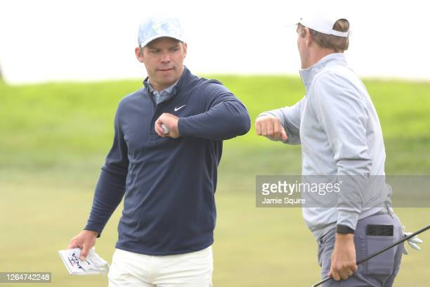 Paul Casey of England and Brendon Todd of the United States show camaraderie on the 18th green during the third round of the 2020 PGA Championship at...