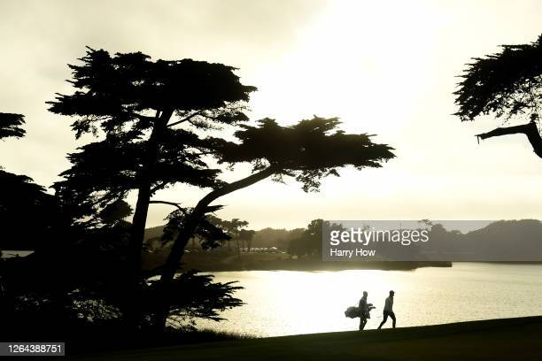 Paul Casey of England and caddie John McLaren walk up the 18th hole during the first round of the 2020 PGA Championship at TPC Harding Park on August...