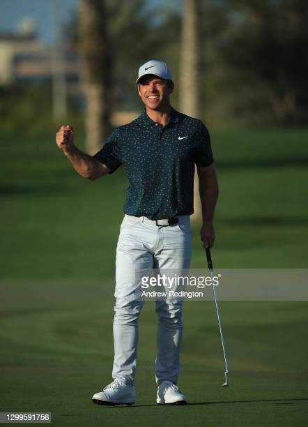 Paul Casey of England celebrates after claiming victory on the 18th hole during the final round of the Omega Dubai Desert Classic at Emirates Golf...