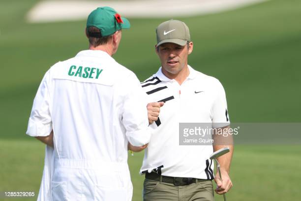 Paul Casey of England celebrates his eagle with John Mcduring the first round of the Masters at Augusta National Golf Club on November 12, 2020 in...