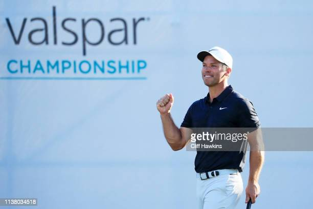 Paul Casey of England celebrates on the 18th green after winning the Valspar Championship on the Copperhead course at Innisbrook Golf Resort on March...