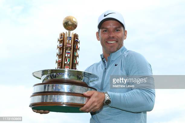 Paul Casey of England celebrates with the trophy following Day 4 of the Porsche European Open at Green Eagle Golf Course on September 08, 2019 in...
