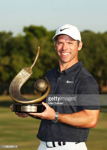 Paul Casey of England celebrates with the winner's trophy after the final round of the Valspar Championship on the Copperhead course at Innisbrook...