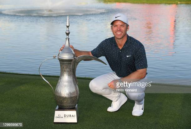 Paul Casey of England celebrates with the winners trophy after the final round of the Omega Dubai Desert Classic at Emirates Golf Club on January 31,...