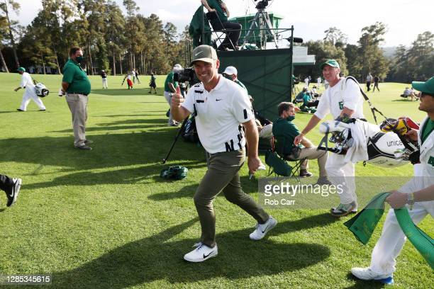 Paul Casey of England gives a thumbs up as he walks off a green during the first round of the Masters at Augusta National Golf Club on November 12,...