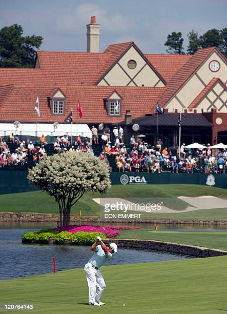 Paul Casey of England hits his approach shot to the 18th green during a practice round of the 2011 PGA Championship Tournament at Atlanta Athletic...