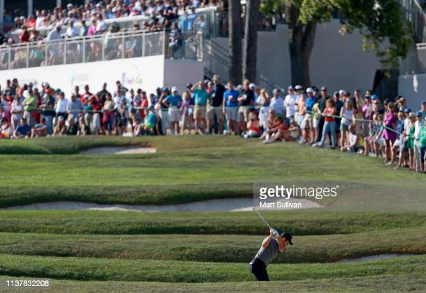 Paul Casey of England hits his second shot on the 18th hole during the third round of the Valspar Championship on the Copperhead course at Innisbrook...
