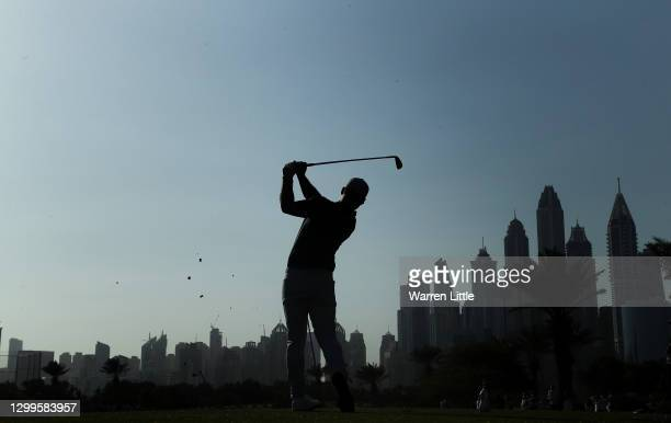 Paul Casey of England hits his tee shot on the 14th hole during the final round of the Omega Dubai Desert Classic at Emirates Golf Club on January...