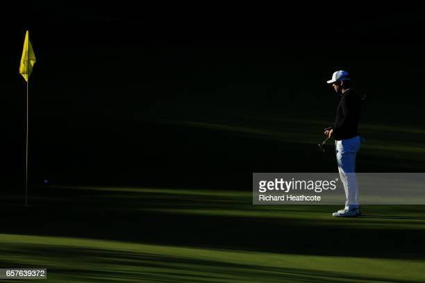 Paul Casey of England lines up a putt on the 2nd hole of his match during round four of the World Golf ChampionshipsDell Technologies Match Play at...