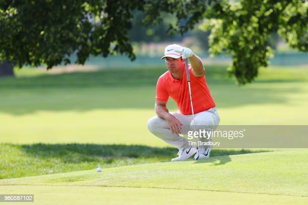 Paul Casey of England lines up a putt on the fifth green during the first round of the Travelers Championship at TPC River Highlands on June 21 2018...