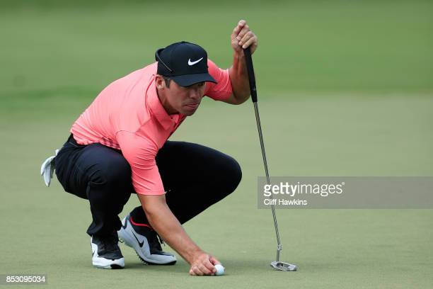 Paul Casey of England lines up a putt on the first green during the final round of the TOUR Championship at East Lake Golf Club on September 24 2017...