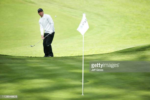 Paul Casey of England pitches to the 17th green during the third round of the AT&T Pebble Beach Pro-Am at Spyglass Hill Golf Course on February 09,...