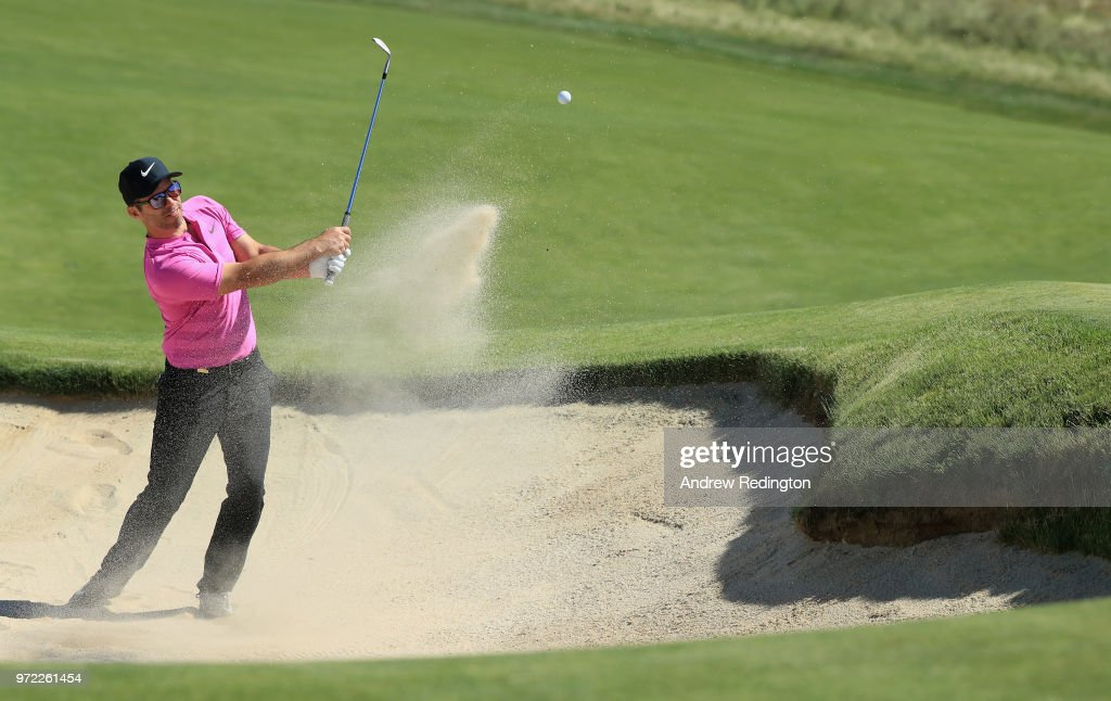 Paul Casey of England plays a shot from a bunker during a practice round prior to the 2018 U.S. Open at Shinnecock Hills Golf Club on June 12, 2018 in Southampton, New York.