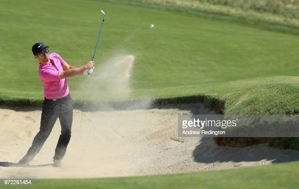 Paul Casey of England plays a shot from a bunker during a practice round prior to the 2018 U.S. Open at Shinnecock Hills Golf Club on June 12, 2018...