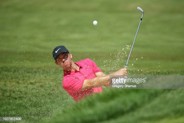 Paul Casey of England plays a shot from a bunker on the 12th hole during the first round of the BMW Championship at Aronimink Golf Club on September...