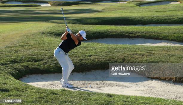Paul Casey of England plays a shot from a bunker on the 18th hole during the final round of the Valspar Championship on the Copperhead course at...