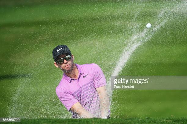 Paul Casey of England plays a shot from a bunker on the second hole during the second round of the WGC HSBC Champions at Sheshan International Golf...