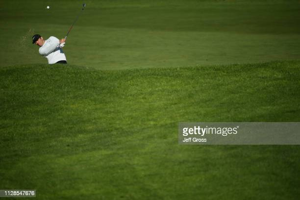 Paul Casey of England plays a shot from a bunker on the sixth hole during the third round of the AT&T Pebble Beach Pro-Am at Spyglass Hill Golf...