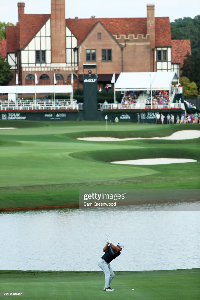Paul Casey of England plays a shot on the 18th hole during the third round of the TOUR Championship at East Lake Golf Club on September 23, 2017 in Atlanta, Georgia.