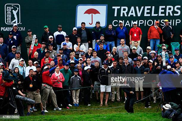 Paul Casey of England plays a shot on the 18th hole in a playoff against Bubba Watson during the final round of the Travelers Championship at TPC...